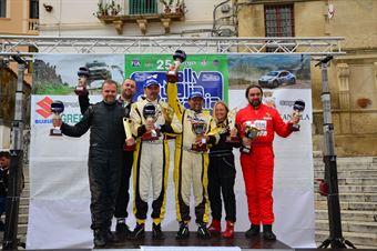 Podium: Lorenzo Codeca, Bruno Fedullo (Suzuki New Grand Vitara 3.6 T1 11 #12, Emmetre Racing), race winner, Tomasz Komormicki, Artur Kotodziej (Mitsubishi L 200 EVO T1 11 #22, G1 Racing) 2nd position, and Andrea Mayer, Roberto Musi (Danisi Light T3 35 #21) 3rd position, CAMPIONATO ITALIANO CROSS COUNTRY